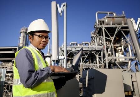 engineer power and energy using laptop on location site photo