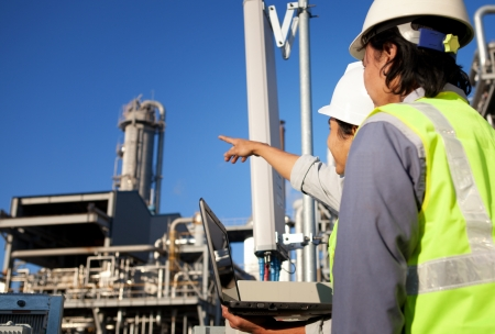 maintenance engineer: two engineer power and energy discussion on location site Stock Photo