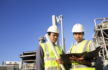 tehnology: two engineer power and energy discussion on location site  Stock Photo