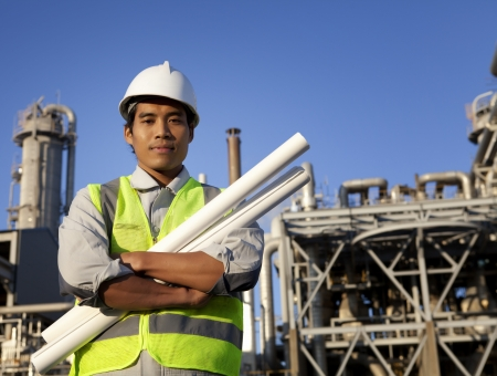 chemical industrial engineer with large oil refinery background photo