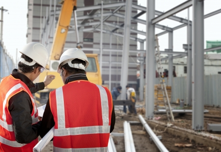 construction safety: two foreman discussion on construction site