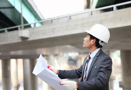 architect  with blueprint on highway construction site Imagens - 17366335