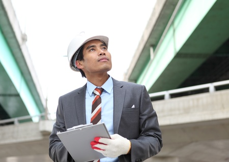 Young architect working on location on a construction site  Stock Photo