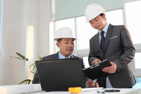 structural engineers: architects sitting at table and discussing a project in the office Stock Photo