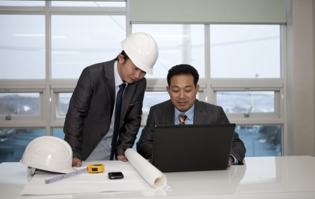 architects sitting at table and discussing project Stock Photo - 17345848