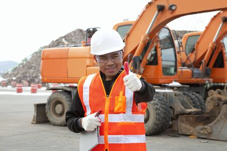 portrait of driver construction equipment showing thumb up smiling Stock Photo - 17345852