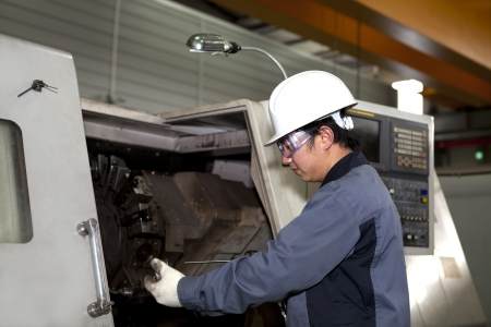 mechanical technician operative of cnc machine  photo