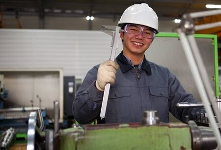 experienced operator:  technician working in factory looking at camera Stock Photo