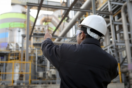oil refinery engineer pointing against pipeline Stock Photo - 17232092