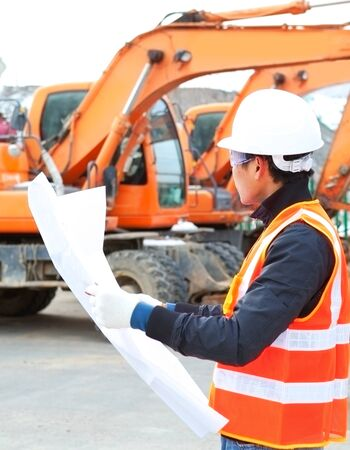 road construction worker front of heavy equipment Stock Photo - 17364530