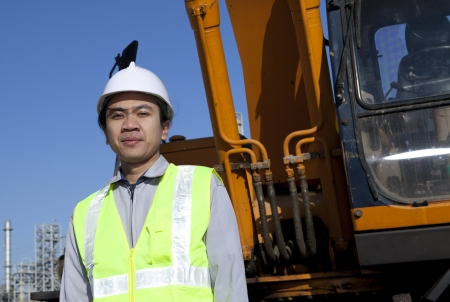 portrait construction worker standing front of heavy equipment Stock Photo - 17930428