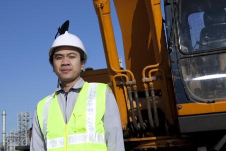 portrait construction worker standing front of heavy equipment Stock Photo - 17930428