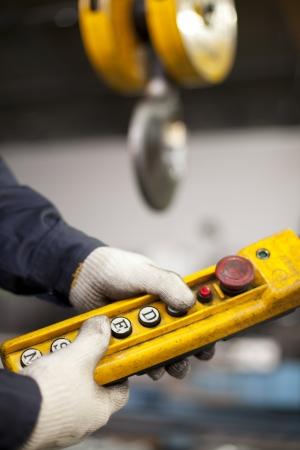 crane parts: Industrial engineer holding crane hook button Stock Photo