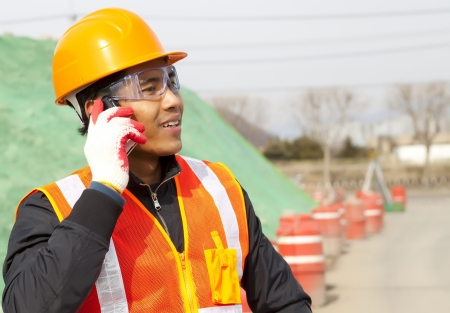 constructor: Construction worker talking on the phone