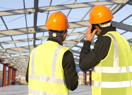 construction engineer with safety vest discussion on location site