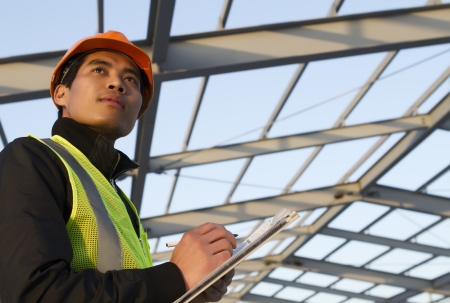 noteboard: Engineer construction under new building checking plan, horizontal image Stock Photo