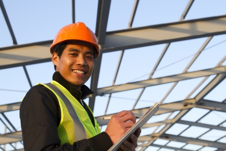 Engineer construction under new building checking plan, horizontal image Standard-Bild