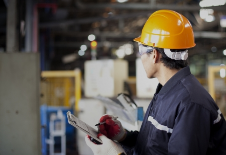 engineering clipboard: Portrait of asian engineer standing in the factory Stock Photo