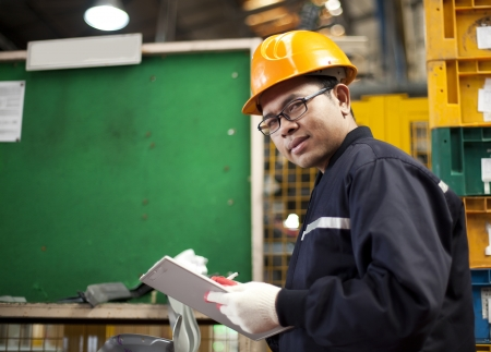Portrait of asian engineer in the factory photo