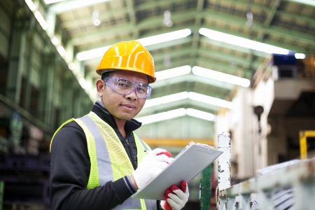 engineering clipboard: Factory worker with clipboard on the hand Stock Photo