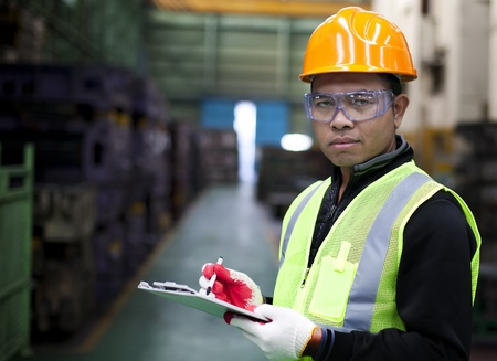 industrial safety: Portrait asian engineer with checklist