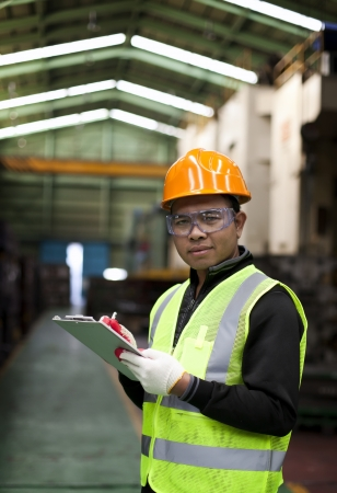 Portrait asian engineer with checklist photo