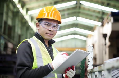 factory worker: Portrait asian engineer with checklist