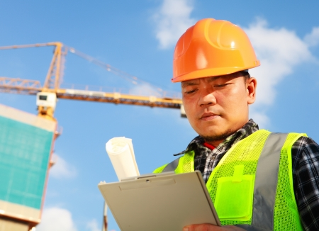 Construction worker activity in front of a crane