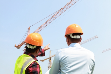 builder worker activity with cranes on the background