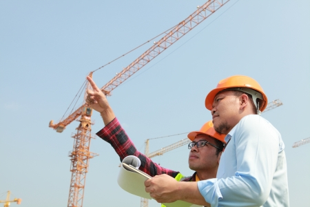 Builder worker and manager inspection  on construction new site photo