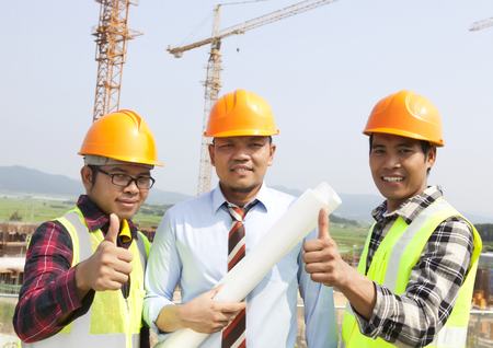 Construction teamwork giving thumbs up photo