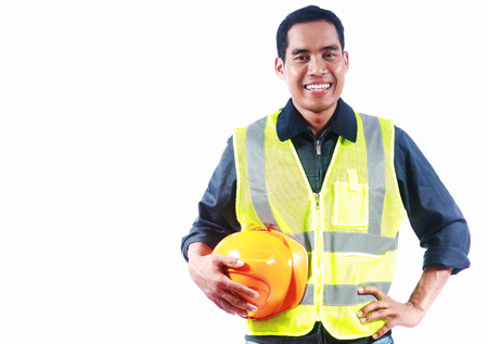 skilled labour: Man engineer holding yellow helmet isolalated on white background Stock Photo
