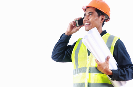 Man engineer holding blueprint, talking on the phone Stock Photo - 24443662