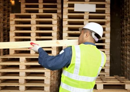 Carpenter checking the board
