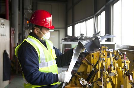 Industrial engineer checking quality metal  Standard-Bild