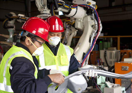 Two engineer discussing in factory photo