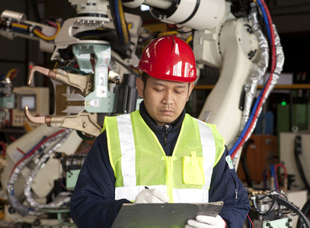 Industry engineer checking data work in clipboard