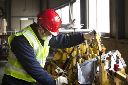 Factory worker on working Standard-Bild