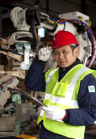 Portrait of young engineer in red hat  Standard-Bild