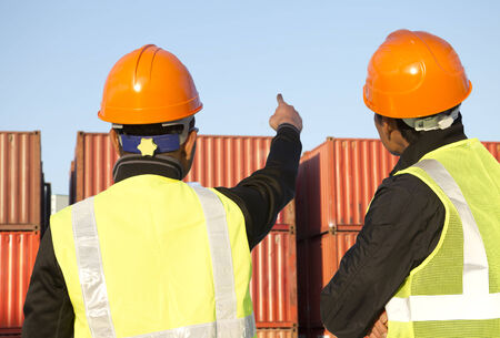 Two workers inspection on  stack of containers photo