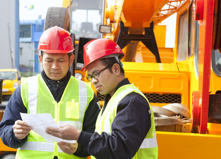 heavy equipment operator: Construction workers discussing new project building Stock Photo