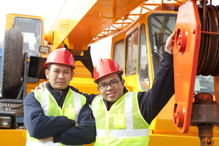Crane truck  posing next to the huge mobile crane photo