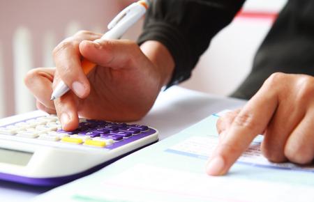 Woman hand accounting financial data Standard-Bild