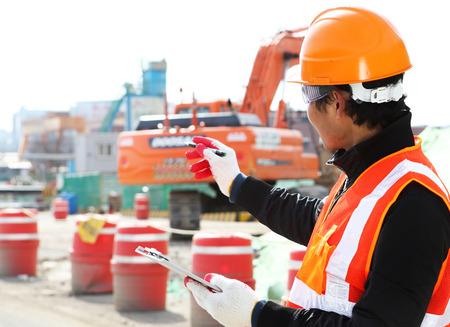 Builder engineer wearing safety work on location construction  Standard-Bild