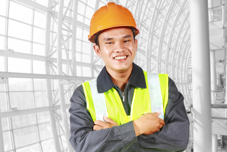 Portrait of construction engineer with pipe line modern building