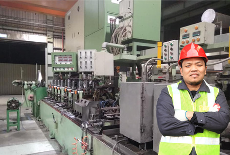 Engineer in front of machine
