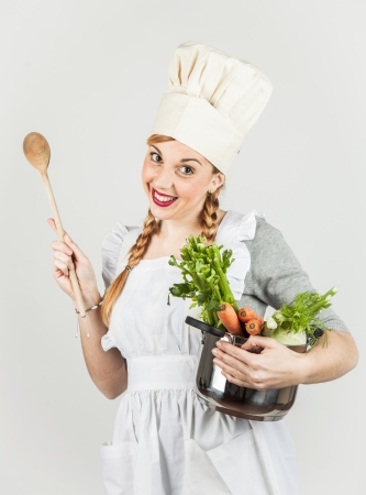 Funny girl with a cook hat