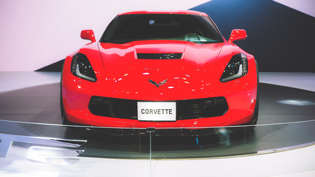 HO CHI MINH  VIETNAM, 04 AUG 2017 - Beauty Model and Red Chevrolet Corvette car on display at Vietnam Motor Show 2017 Editorial