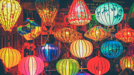 Colorful lanterns at the market street of Hoi An Ancient Town . Vietnam