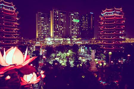 Pagoda in city at night